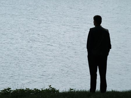 alone: Man silhouette at lakeside