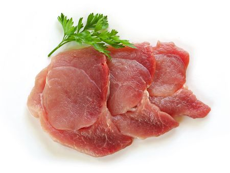 Three slices of fresh meat with parsley