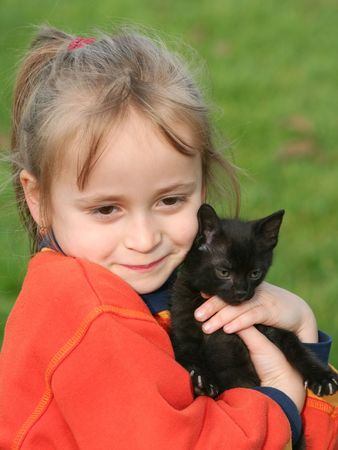 Little girl with cat kid Stock Photo - 690101