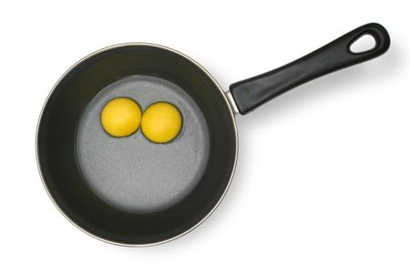Raw eggs in the pan Stock Photo