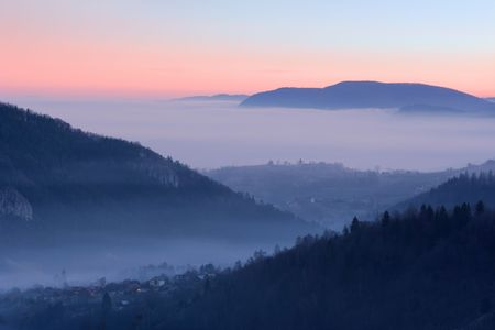 Morning view of a village between the mountains photo