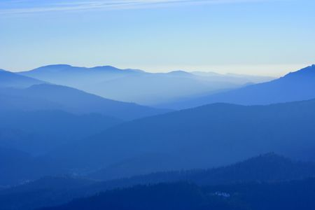 arcane: View of far away blue mountains in the fog