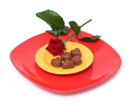 Chocolate heart on plates and a rose Stock Photo - 733496