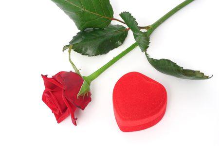 Red rose and a heart-shaped gift box photo