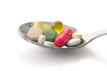 Close view medications in spoon photo