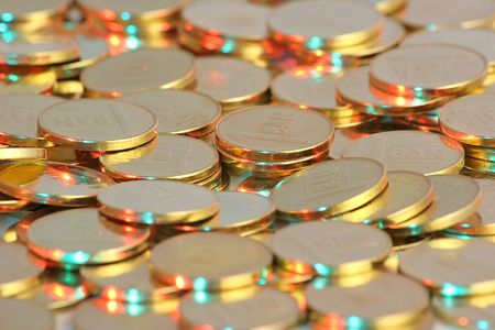 Golden coins illuminated with red and blue light Stock Photo - 746147