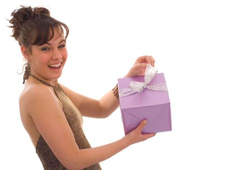 Happy girl, showing a purple gift box Stock Photo - 763762