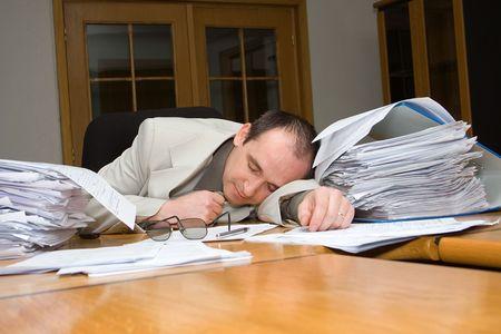 wearied: Businessman felt asleep late night in the office
