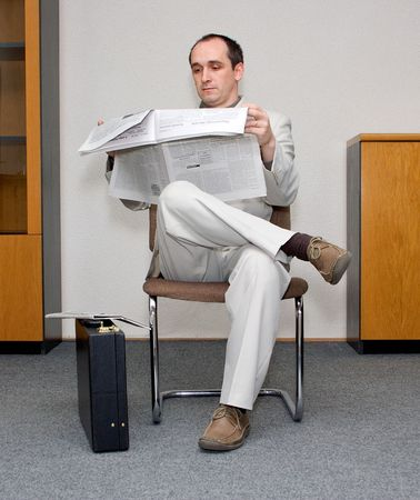 Businessman waiting and reading the papers Stock Photo - 873555
