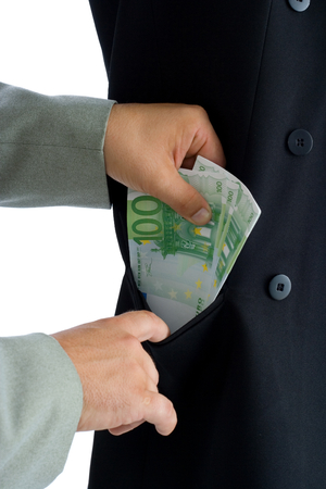 corruptible: Hands putting several hundred euros into a pocket