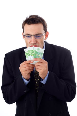 Businessman trying to smell the money Stock Photo - 1576874