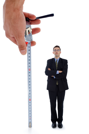 Measuring a men. Metaphoric view of a test before employment photo