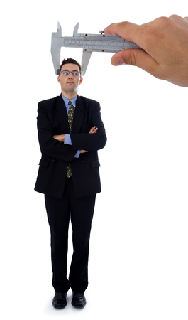 Measuring a men's head. Metaphoric view of a test before employment Stock Photo - 1576855