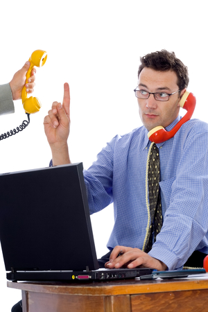 else: Businessman talking on the phone while somebody else is on the line