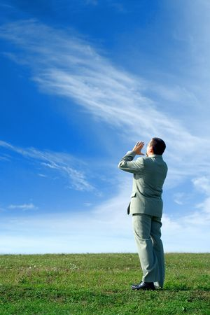 Businessman in the nature, shouting loud, communicating an important message to everyone Stock Photo - 1950616