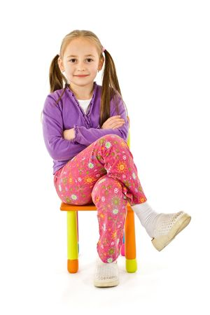 Smiling little girl sitting on a small chair Stock Photo - 2257176