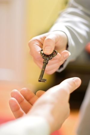 Hands exchanging the key to success Stock Photo - 2324373