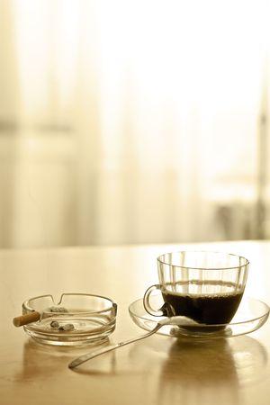 Coffee break and smoking a cigarette [in sepia tone] photo
