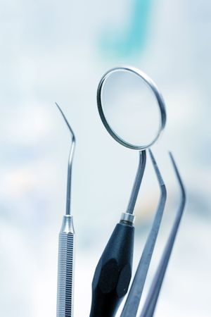 a round of inspection: Dentist tools in blue light (shallow DOF) Stock Photo