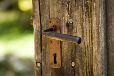 Old wooden door with rusty iron handle Stock Photo - 4244254