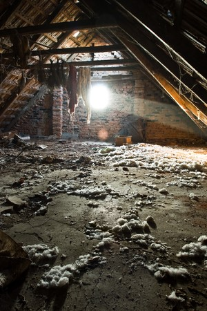 Sun rays lighting the garbage in an old attic Stock Photo - 4328570