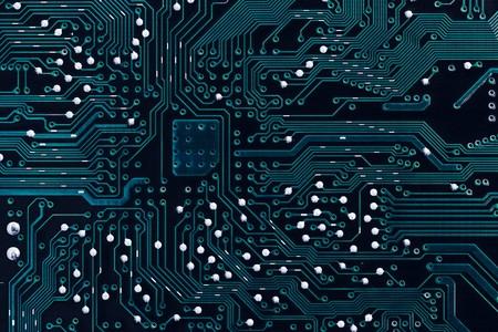 solder: Blue printed circuit board background (solder side) Stock Photo