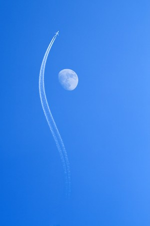 Jet airplane bypassing the moon Stock Photo - 4328424