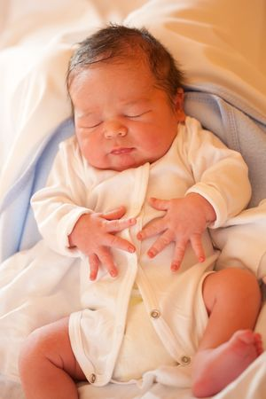 New born baby boy sleeping photo