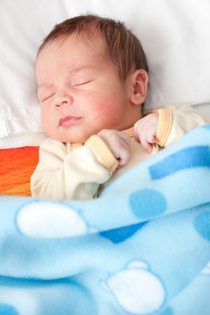 New born baby sleeping in bed Stock Photo