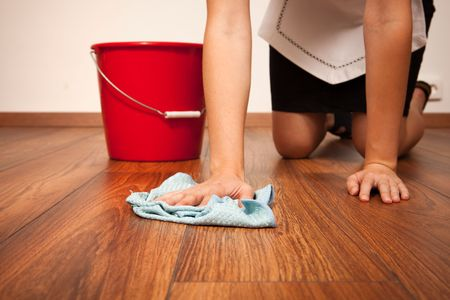 Woman cleaning the floor with blue cloth Stock Photo - 6824314