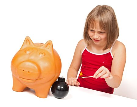 Girl preparing to explode piggy bank with bomb photo