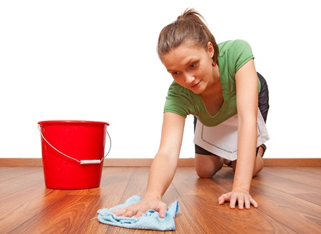 floor cloth: Service woman cleaning the wooden floor with cloth Stock Photo
