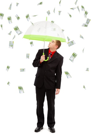 Young man under umbrella, looking up to the money rain of 100 euro banknotes
