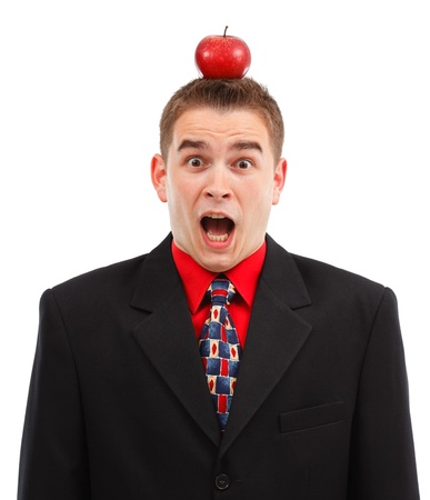 red head: Very scared business man being target with red apple on the head