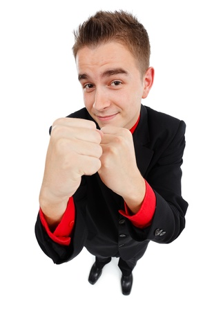 invincible: Confident young invincible business man showing fists and smiling