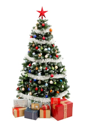 Artificial christmas tree isolated on white, decorated with colorful ornaments and silver garland, a lot of presents under the tree