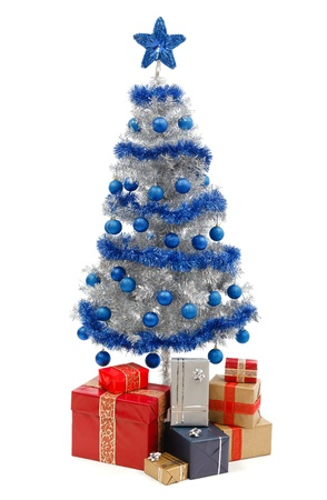 artificial: Artificial silver christmas tree isolated on white, decorated with blue ornaments and silver garland, a lot of presents under the tree