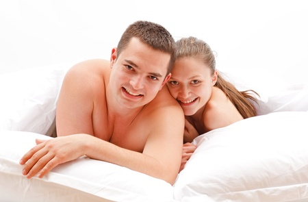 Happy young couple laying in bed Stock Photo - 8922847