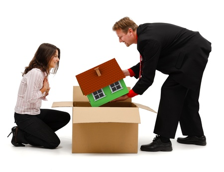 Business man or husband unpacking a miniature new house for his wife or client photo