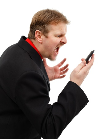 Impatient business man yelling on mobile phone Stock Photo