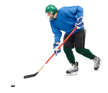 Ice hockey player in blue wear, skating fast and handling puck photo