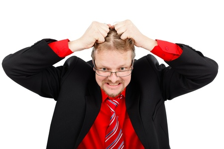 Angry distressed business man pulling his hair photo
