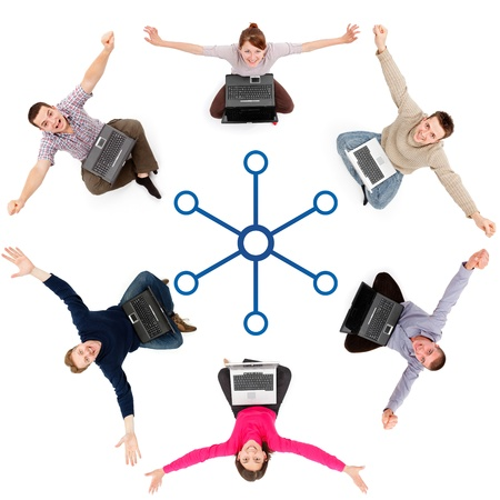 Young people sitting around with laptops, being part of social network Stock Photo - 9198323
