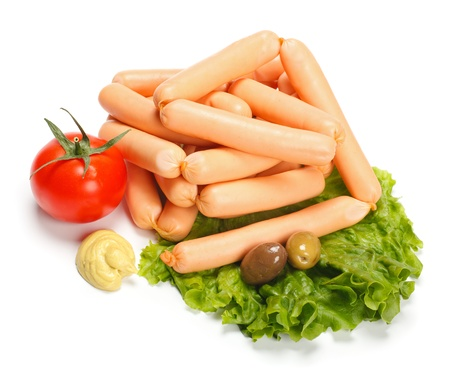 weenie: Weenie sausages with mustard and various vegetables Stock Photo