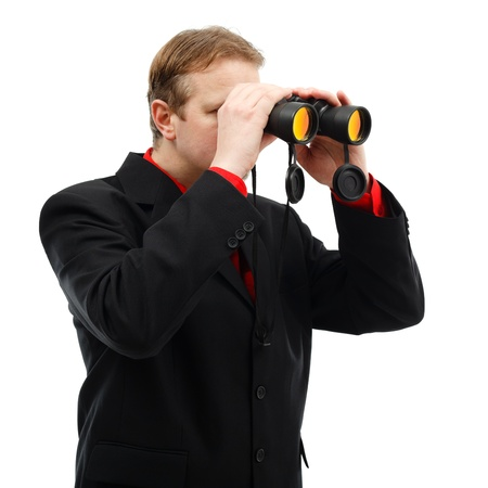 Man looking through binoculars finding new opportunities photo