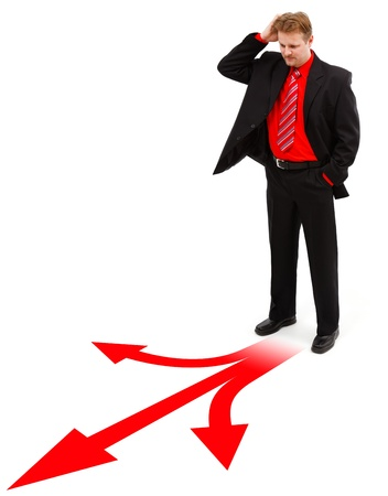 Man standing in front of decisions shown by red arrows