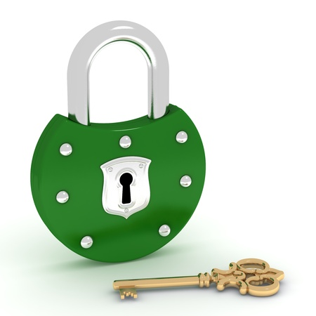 Old style green padlock and golden key photo