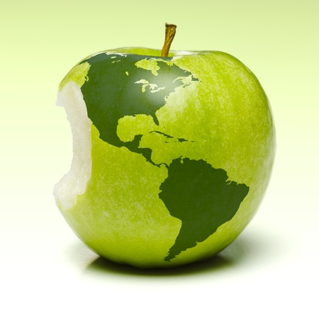 Whole green apple with planet earth map applied (americas) photo