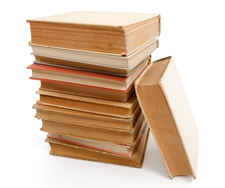 slant: Pile of old books with one slanting on them