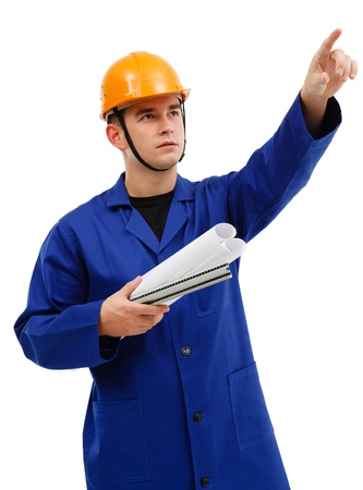 Serious engineer with yellow helmet, holding rolls of projects, pointing upwards Stock Photo - 10658849